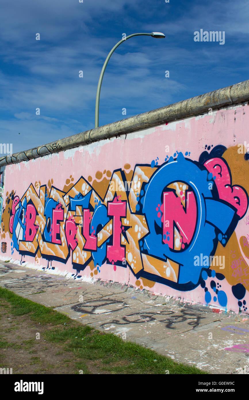 berlin graffiti on berlin wall  east side gallery - Stock Image