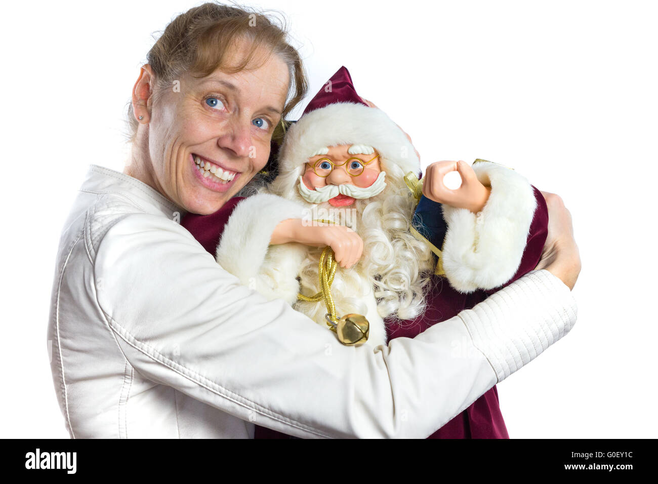 Caucasian woman embracing model of Santa Claus - Stock Image