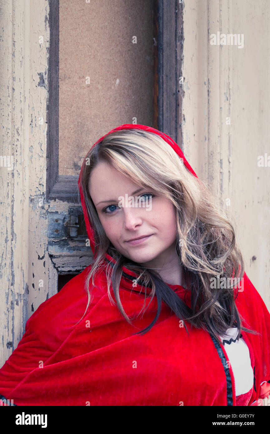 Woman with red costume - Stock Image
