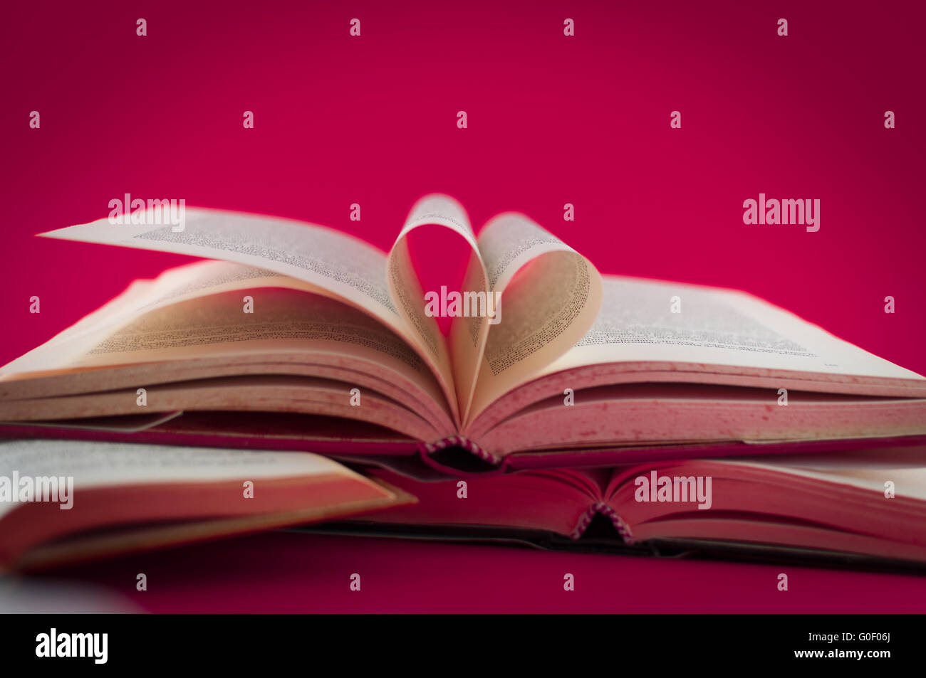 books open on colored background Stock Photo