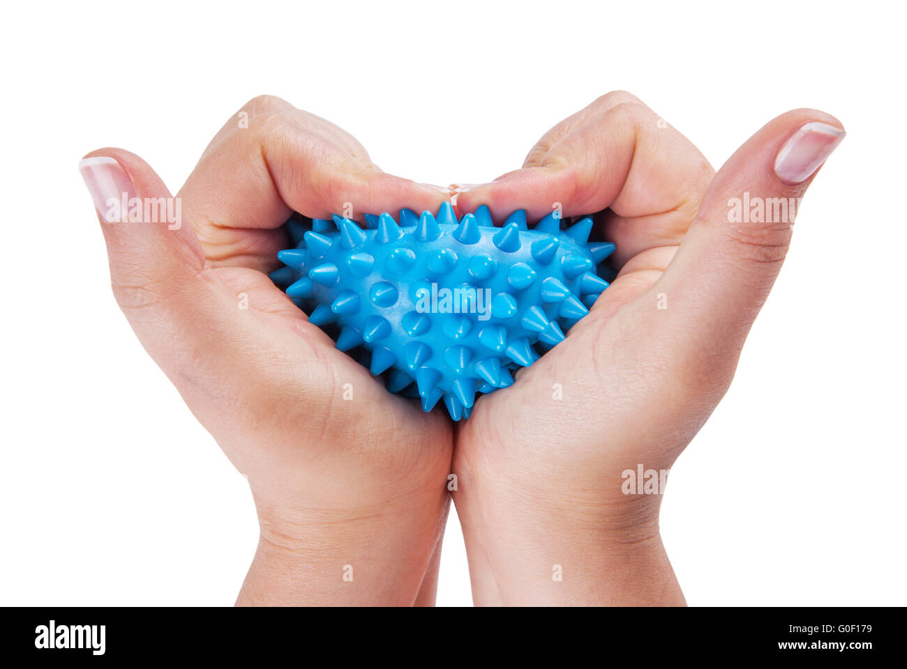 Woman hands with massage ball - Stock Image