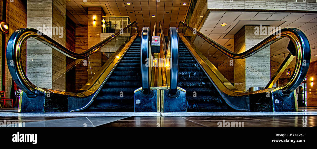 wide panoramic angle of escalator flow low point Stock Photo
