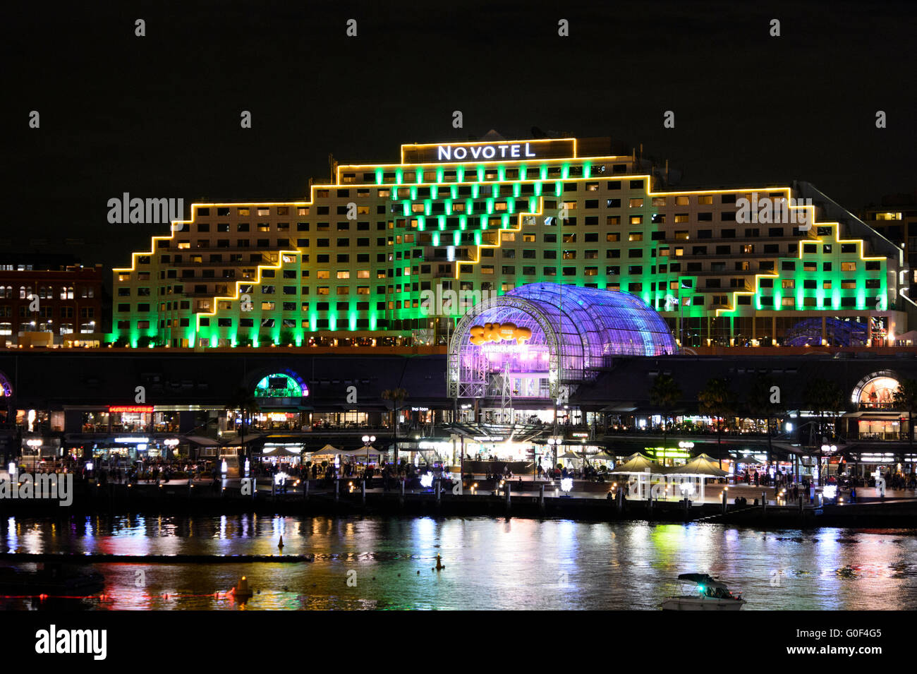 Hotel Novotel is illuminated during Vivid Festival, Darling Harbour, Sydney, New South Wales, Australia - Stock Image