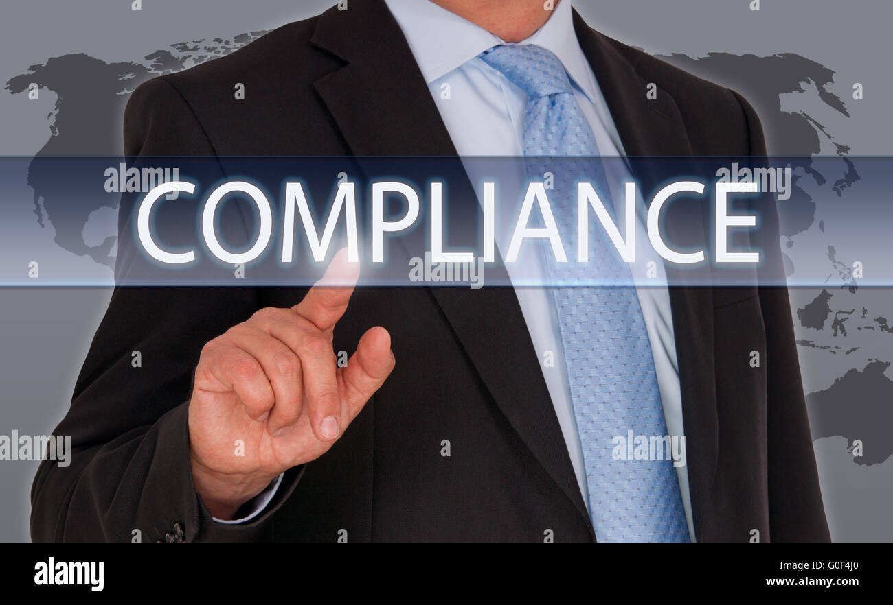 Compliance Manager with touchscreen - Stock Image