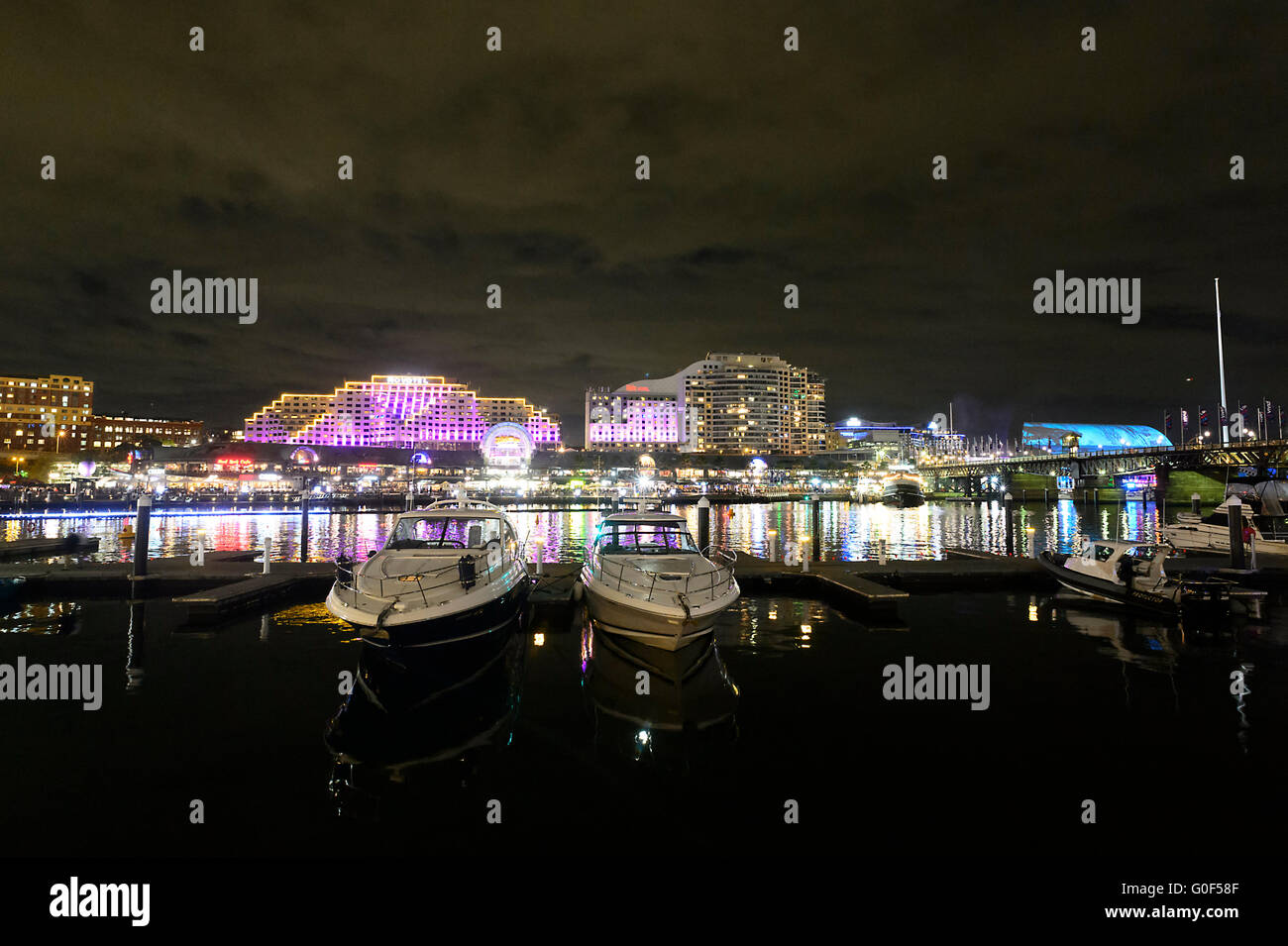 Darling Harbour Marina at night with the Novotel Hotel in the background, Sydney, New South Wales, Australia - Stock Image