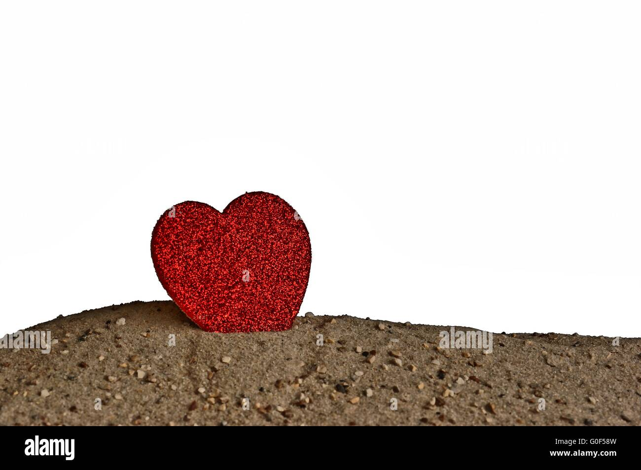 Heart standing in the sand - Performer Stock Photo
