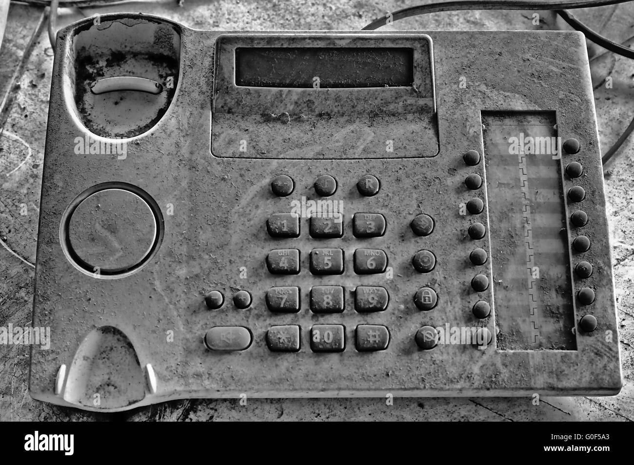 Filthy telephone without handset - Stock Image