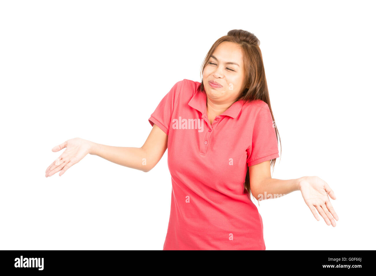 Laughing Asian Woman Shrugging Shoulders - Stock Image
