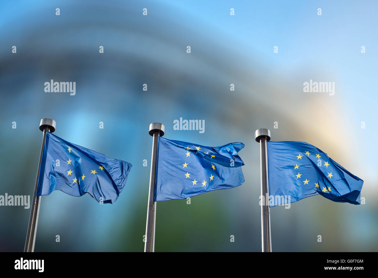 European Union flags against European Parliament - Stock Image