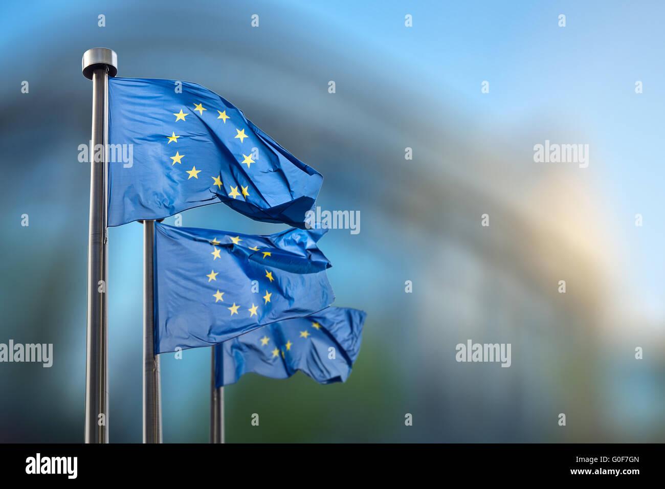 European Union flags against European Parliament - Stock Image