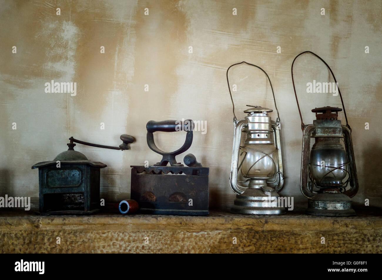 Kerosene lamp iron coffee grinder on open fire - Stock Image