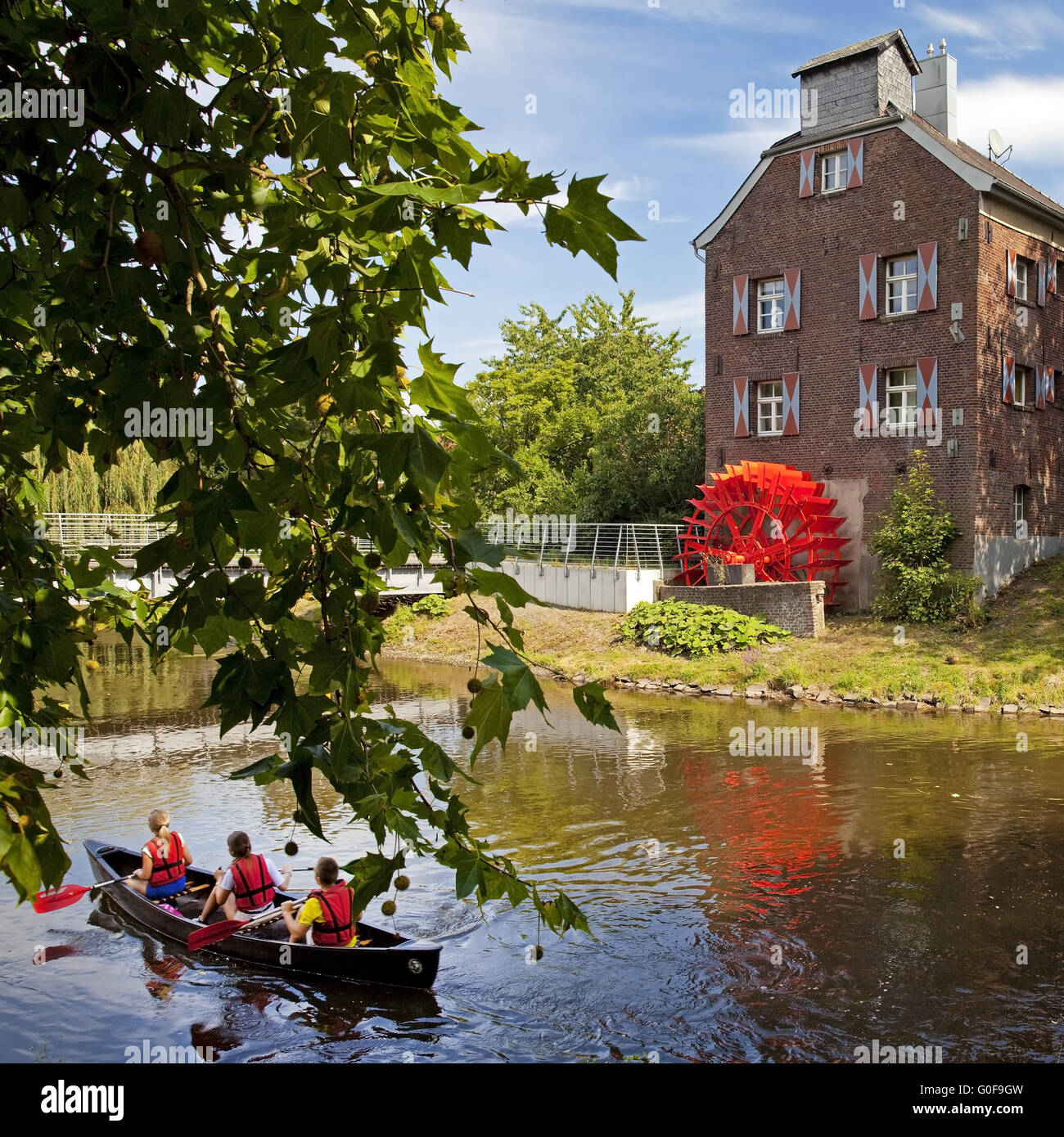 Canoeist on the Niers with Susmuehle, Goch Germany - Stock Image