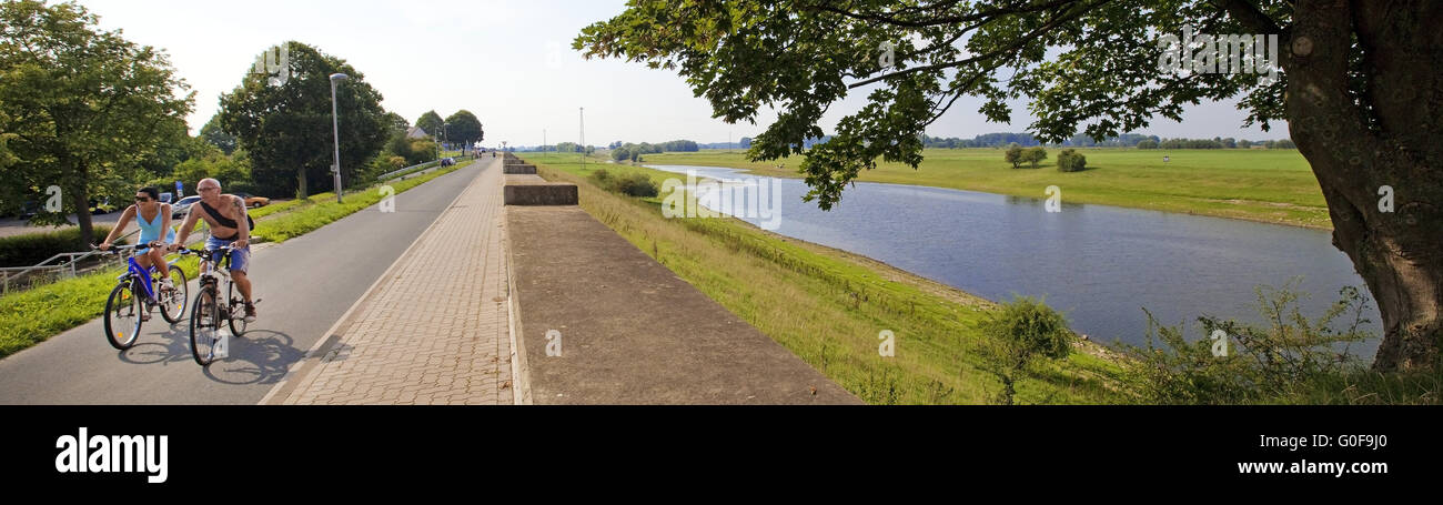 Two bicyclist on the dike on the Old Rhine, Kleve - Stock Image