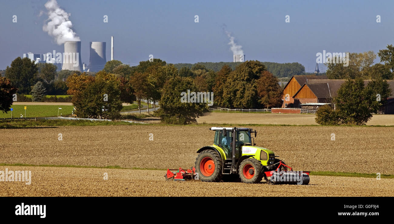 Tractor in front of the Westfalen power plant - Stock Image