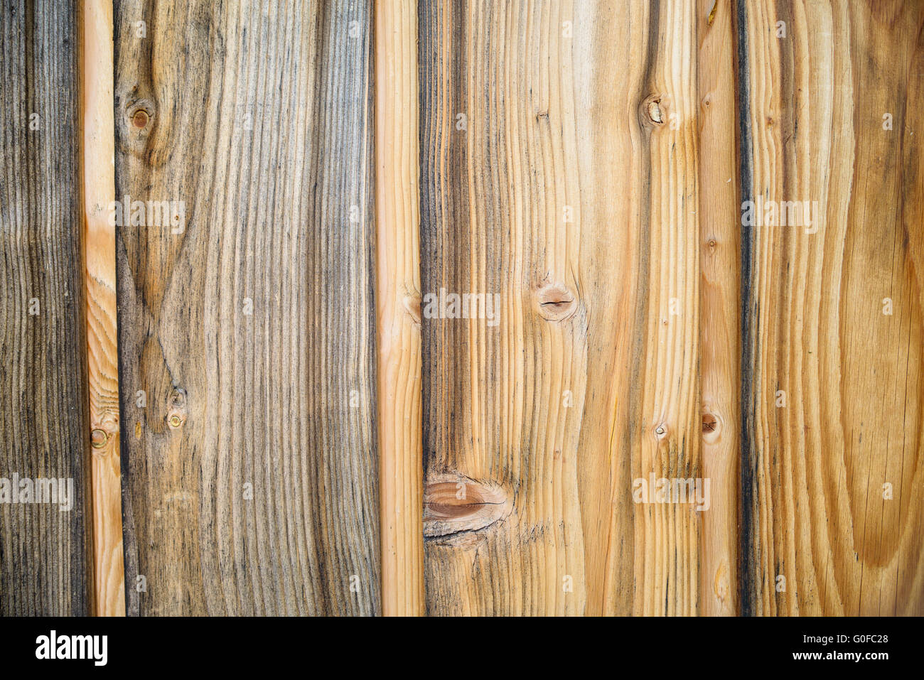 Wood Background Texture. Rustic weathered barn wood background with knots and scratches - Stock Image