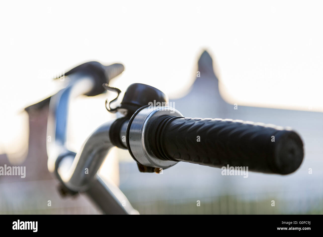 Bicycle handlebars with ringing in the diffuse backlight. - Stock Image