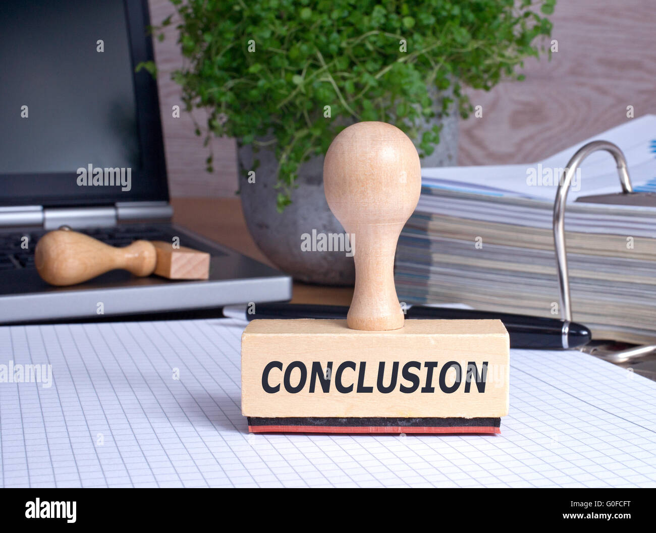 Conclusion rubber stamp in the office - Stock Photo