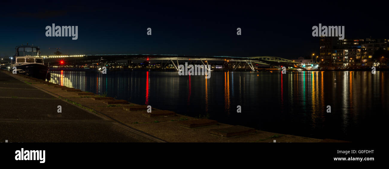 Night Panoramic View On The Modern Bridge In Amsterdam Stock Photo