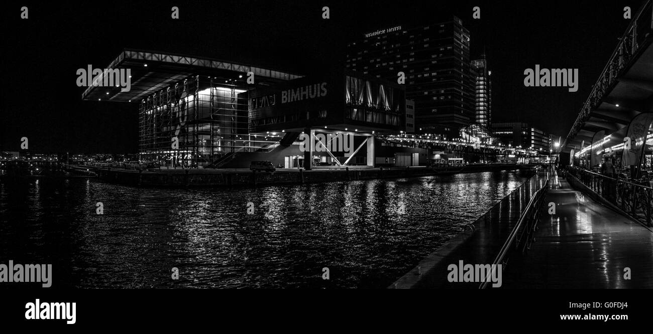 Black white night panoramic view on Jazz Hall and harbour in Amsterdam Stock Photo