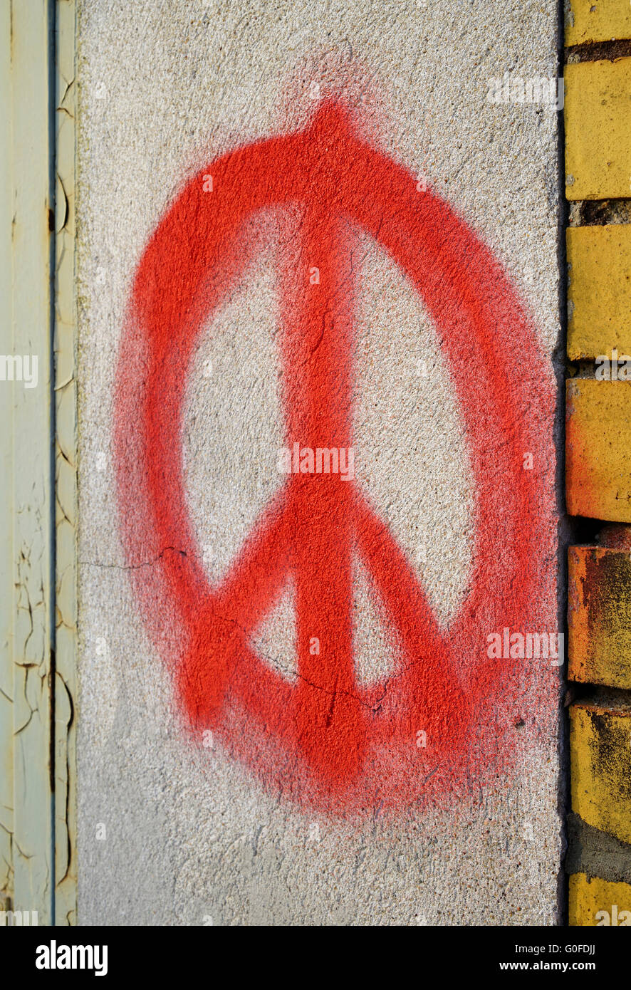 Peace symbol on the facade of a house in Magdeburg - Stock Image