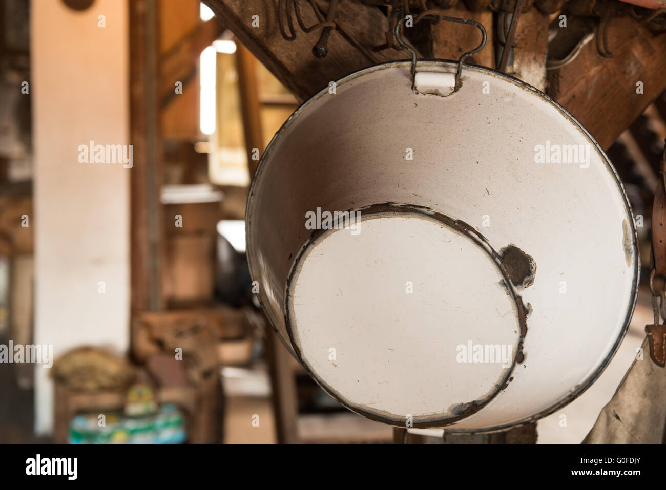 Old Enamel Bowl on an Attic - Stock Image