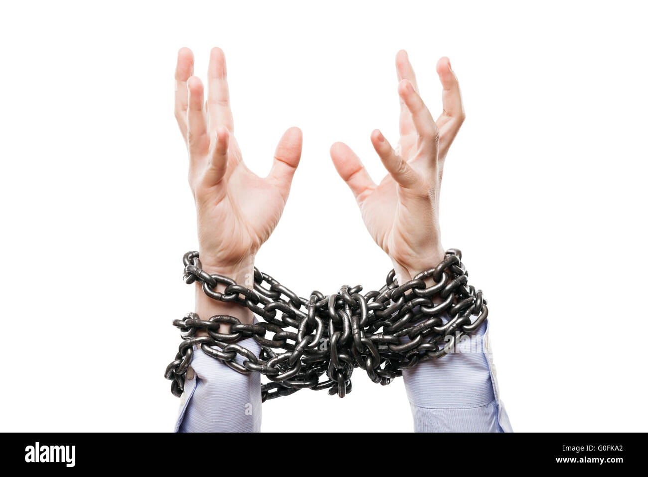 Businessman metal chain tied hands raised for help - Stock Image