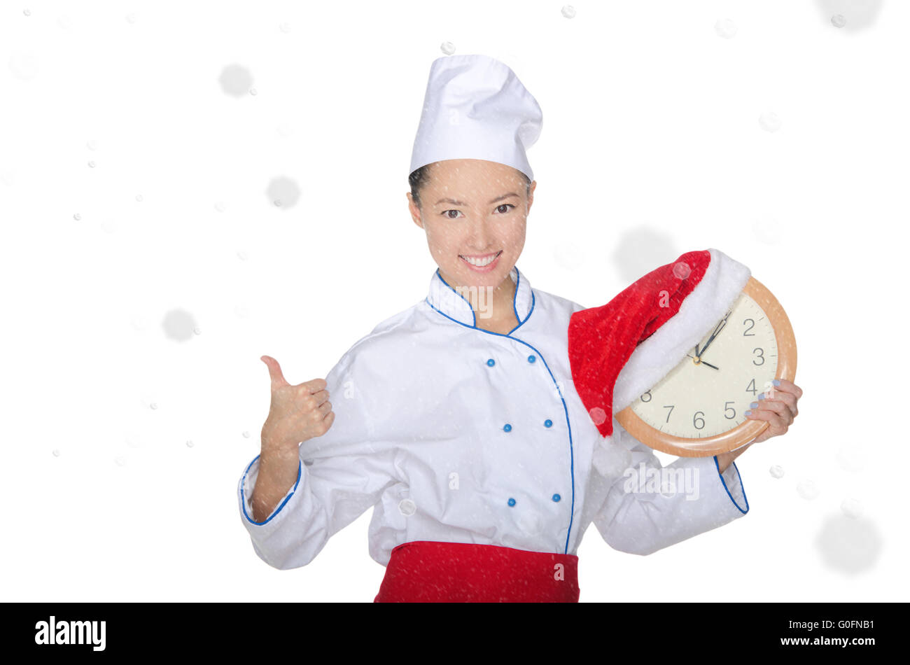 beautiful asian chef with clock and Christmas hat Stock Photo