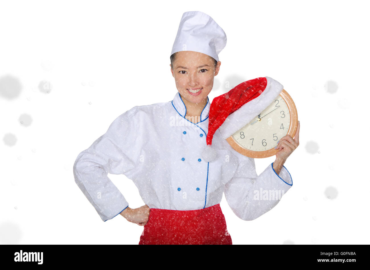 Asian chef with clock and Christmas hat - Stock Image