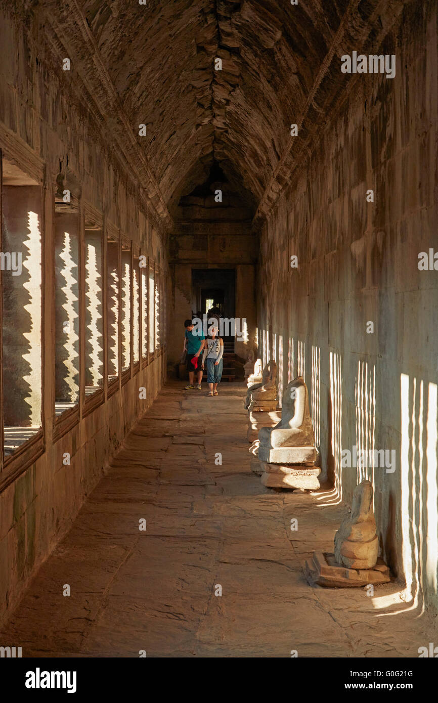 Hallway and tourists, Inner Gallery, Angkor Wat (12th century Khmer temple), Angkor World Heritage Site, Siem Reap, - Stock Image
