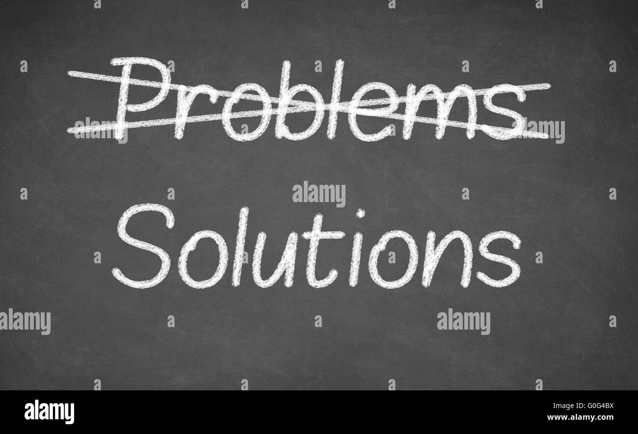 Crossing out problems and writing solutions on a blackboard. - Stock Image