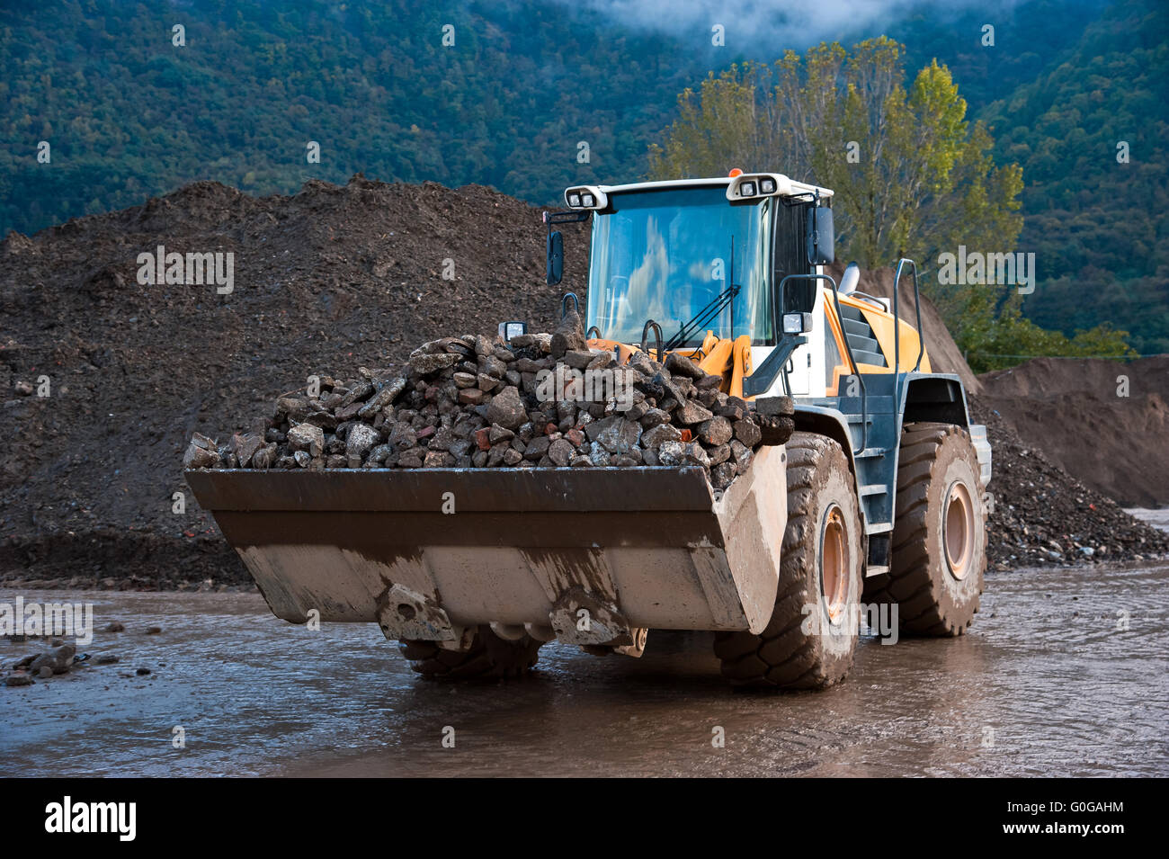 Bulldozer at work in a cave - Stock Image