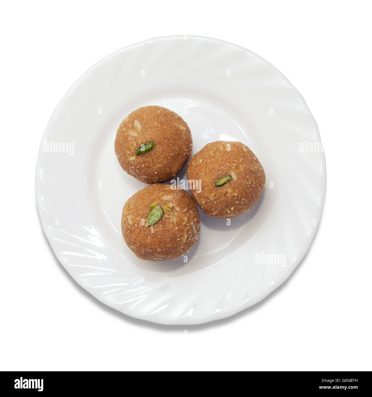 Indian sweets on a plate - Stock Image
