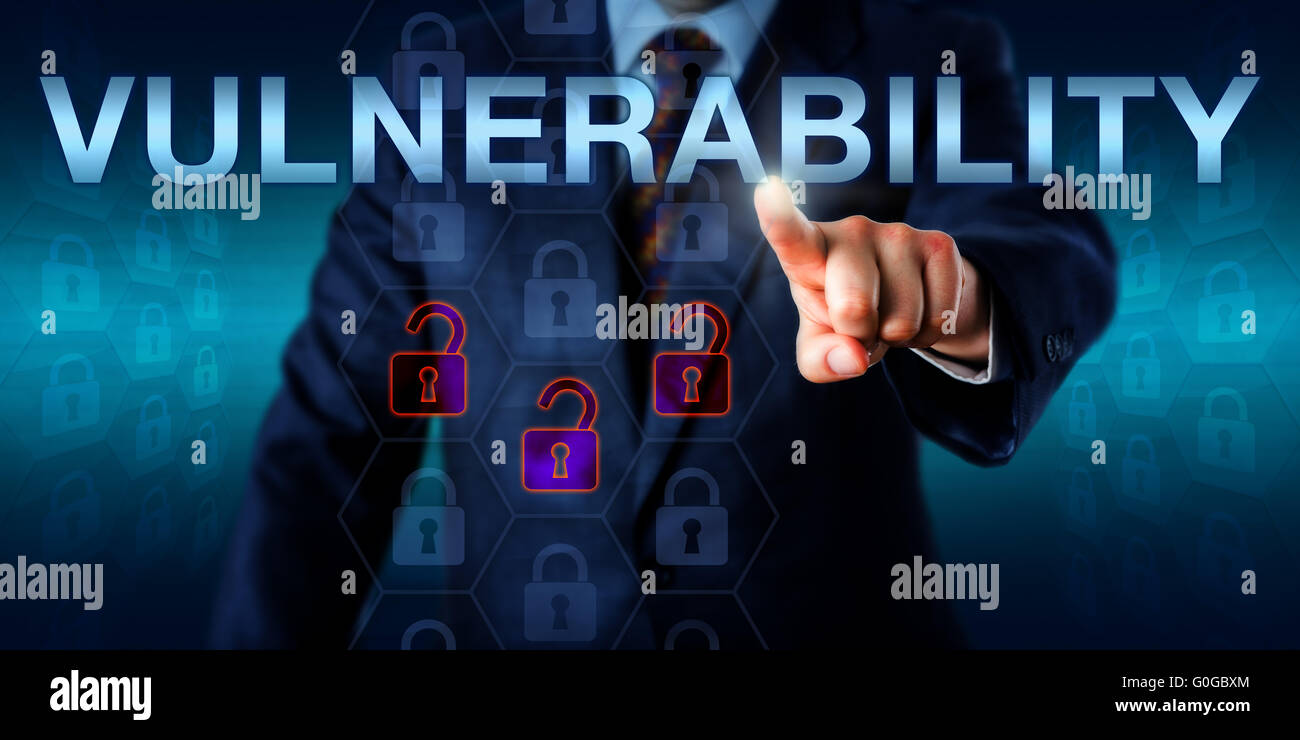 Attacker Pressing VULNERABILITY Onscreen - Stock Image