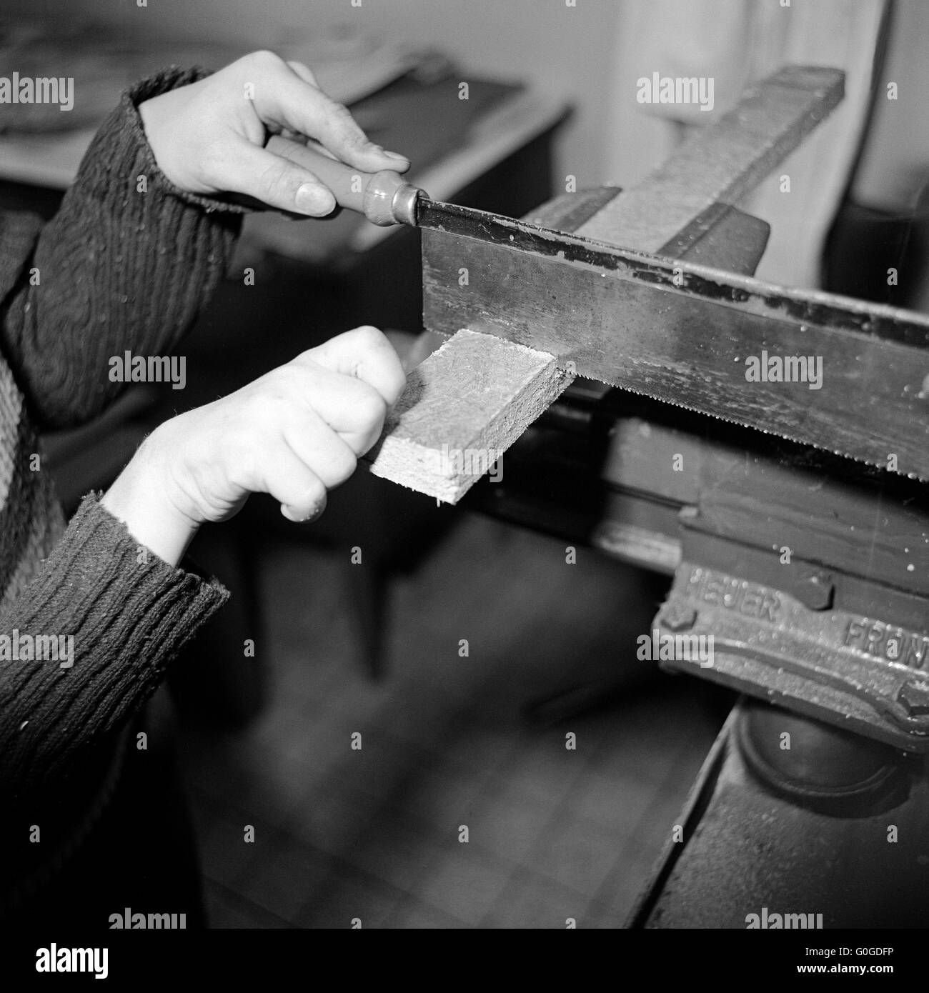 Seventies, black and white photo, people, physical handicap, school, school lessons, crafting, hands of a schoolgirl, - Stock Image
