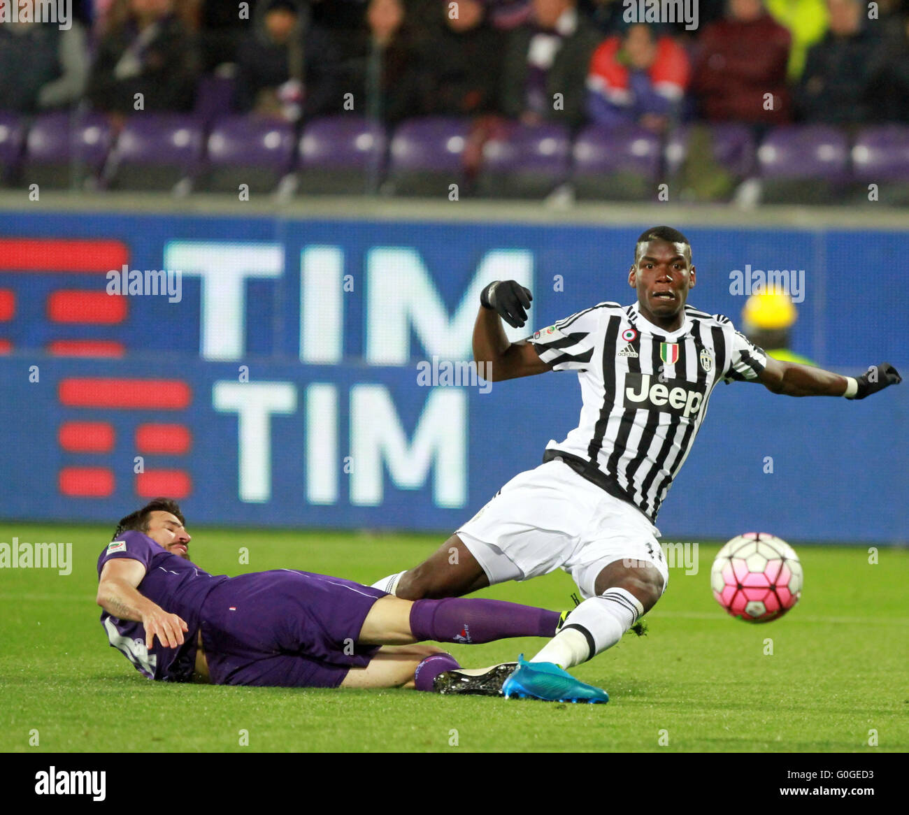 ITALY, Florence: Juventus's midfielder Paul Pogba fall down by Fiorentina's defender Nenad Tomovic (L) during - Stock Image
