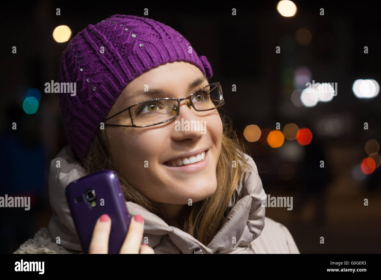 Young woman girl with cell phone mobile in winter or fall outdoors - Stock Image