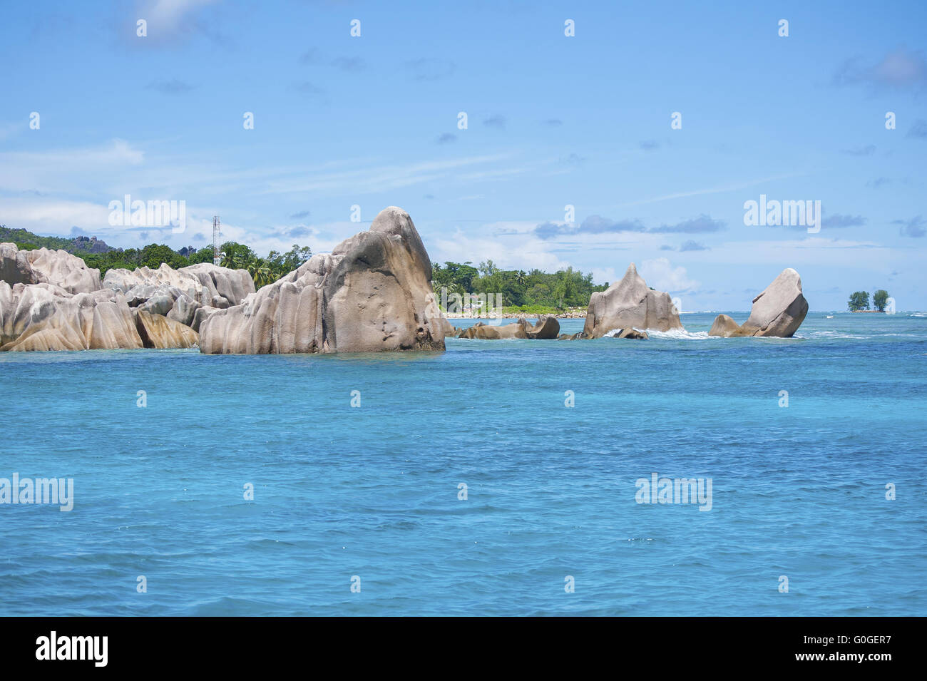Indian Ocean and boulders in the Seychelles. Stock Photo
