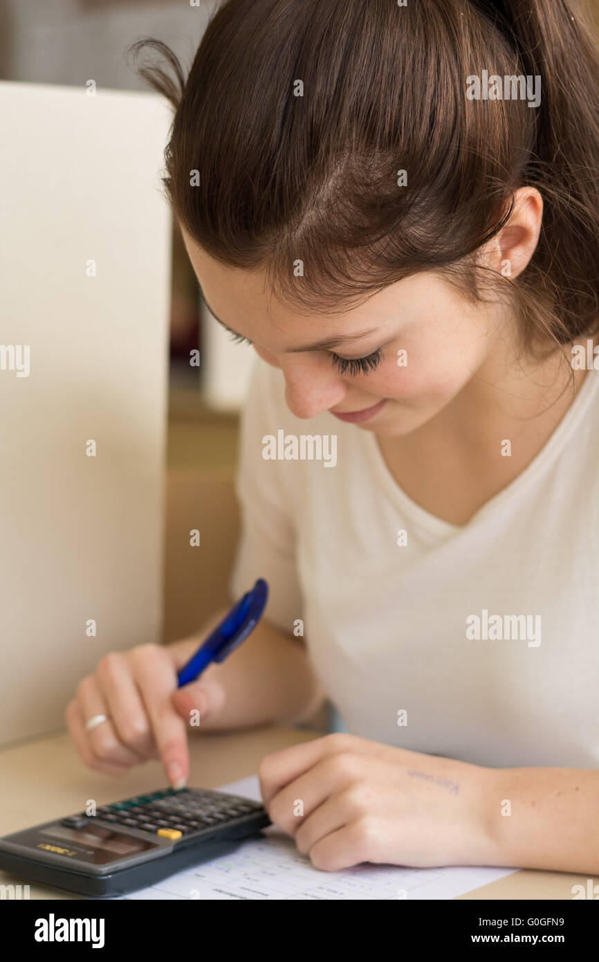 Close - student makes a test and counted on calculator - Stock Image