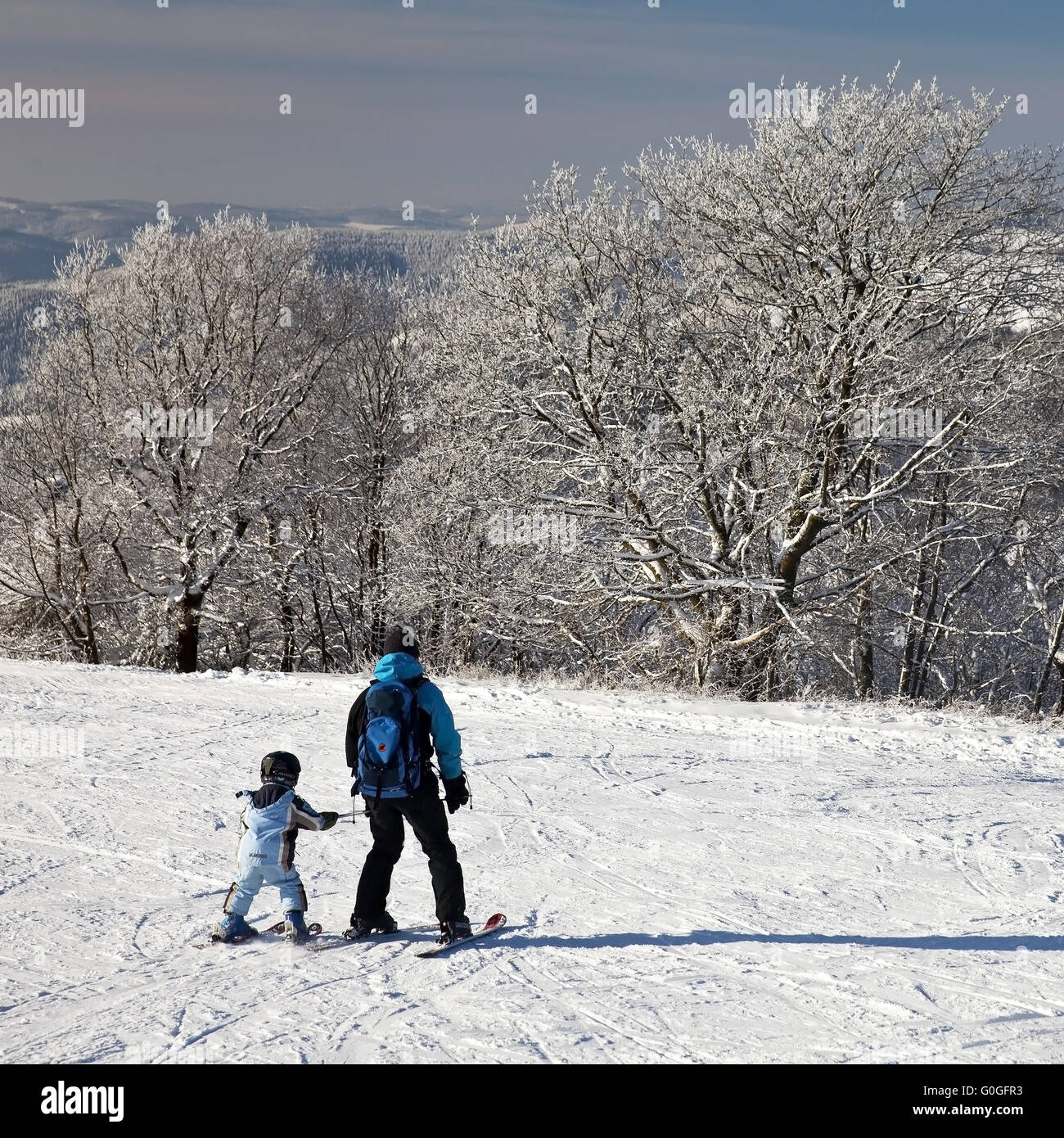 father and son skiing on a ski piste of Wildewiese, Germany, Sauerland, Sundern - Stock Image