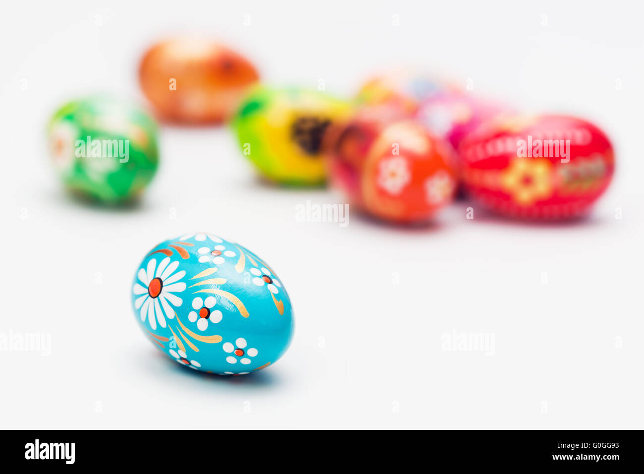 Handmade Easter eggs isolated on white. Floral - Stock Image
