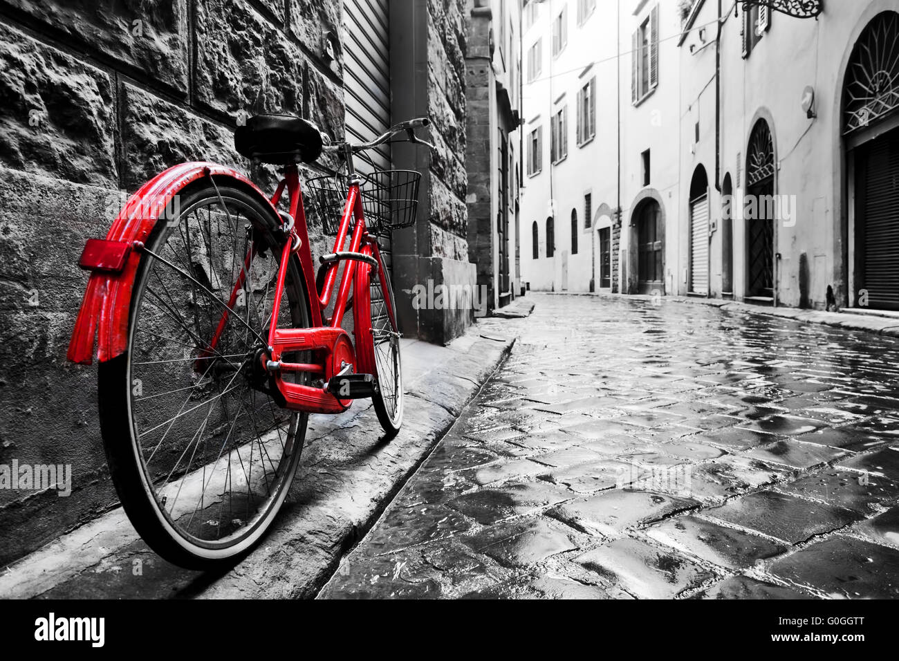 Retro vintage red bike on cobblestone street in the old town. Color in  black and white 2aca99df8