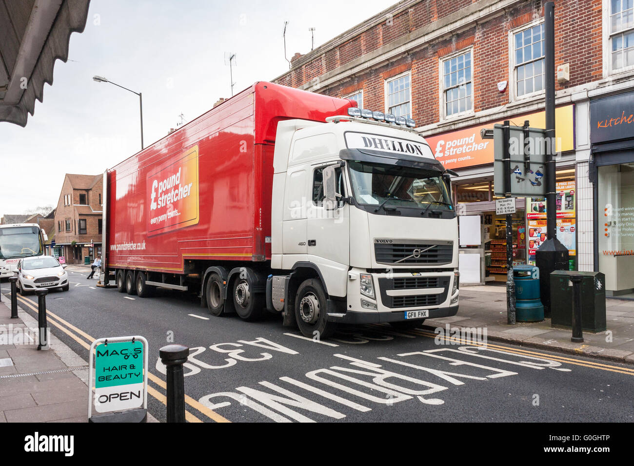 HGV vehicle delivering goods to a Poundstretcher store. - Stock Image