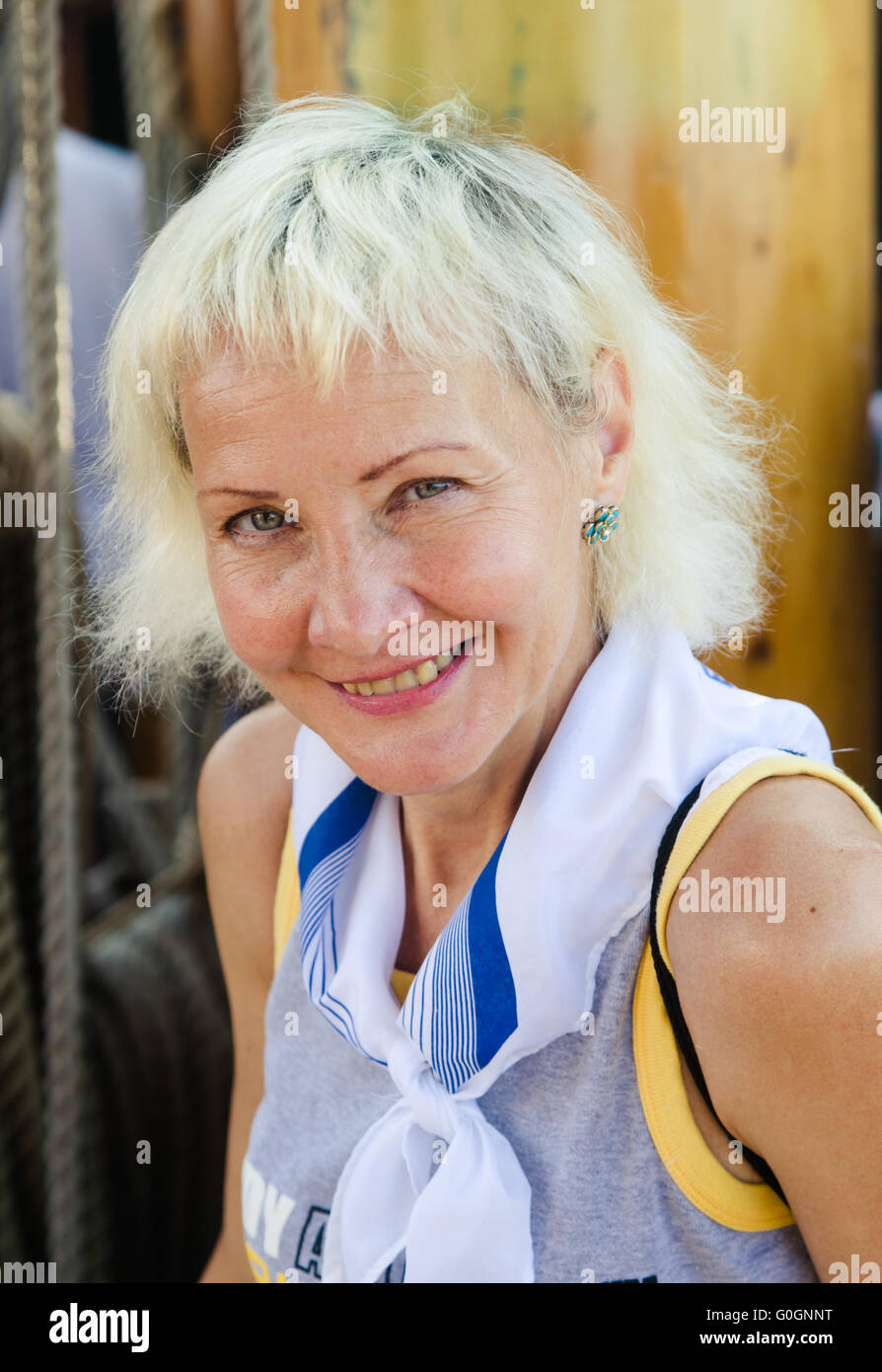 Portrait of a cheerful woman on sailboat - Stock Image