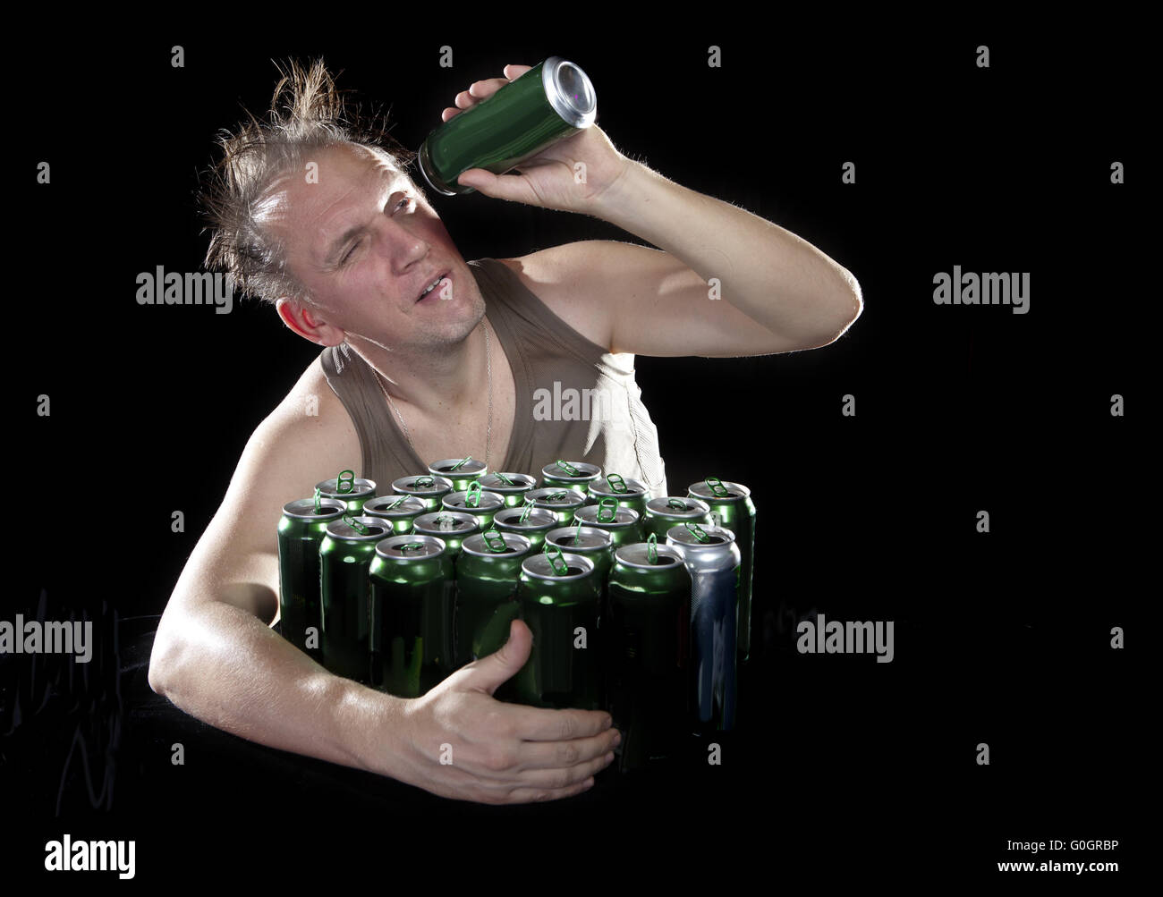 Hangover. The man examines, whether there is no beer drop in a can - Stock Image