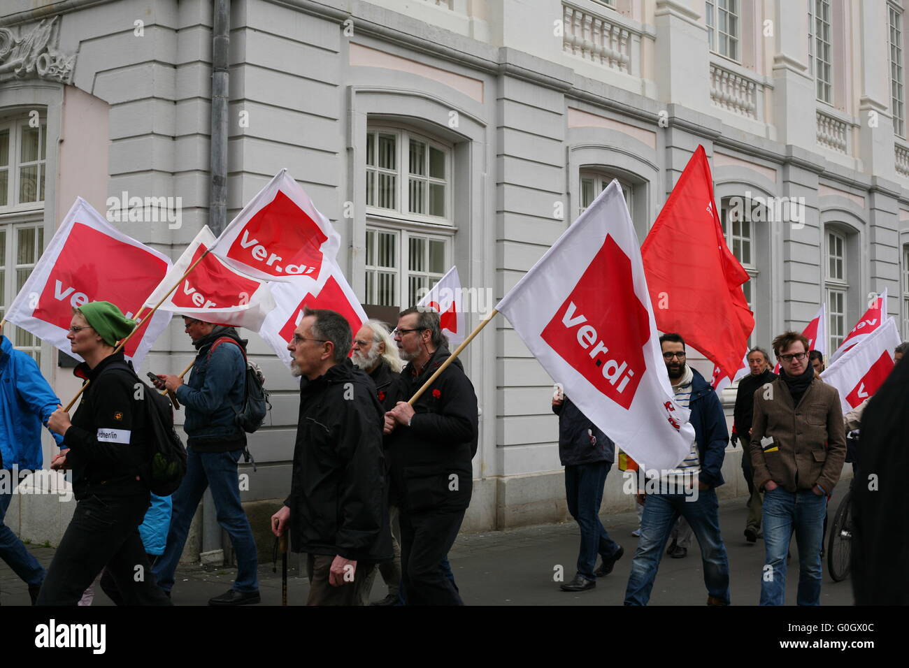 some members of the ver.di trade union with flags, on the way to the market place in Bonn, Germany - Stock Image