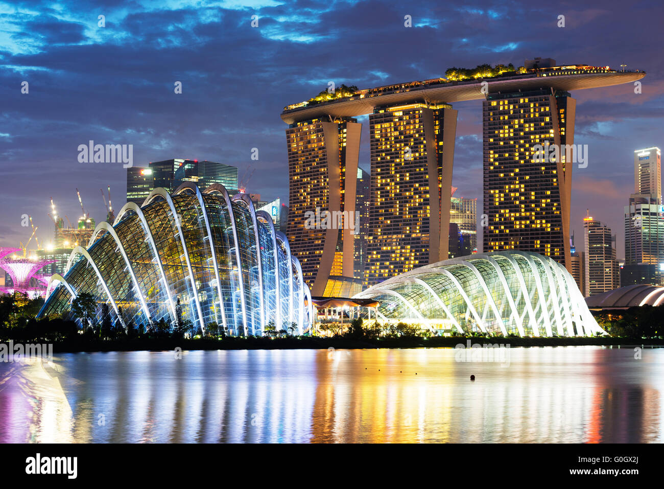 South East Asia, Singapore, Gardens by the Bay, Cloud Forest, Flower Dome, Marina Bay Sands Hotel and Casino Stock Photo