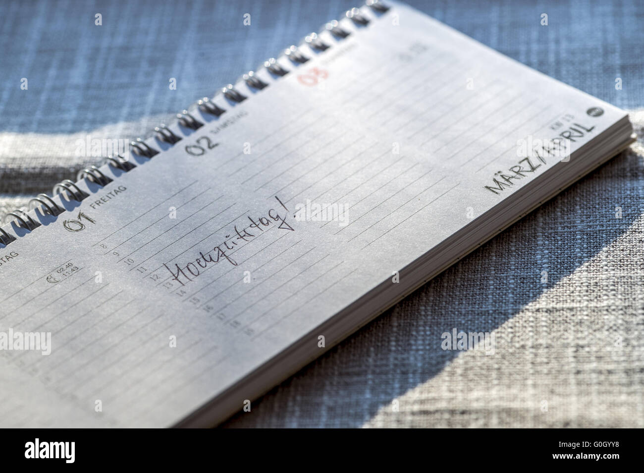 An opened desk calendar with the entry wedding. - Stock Image