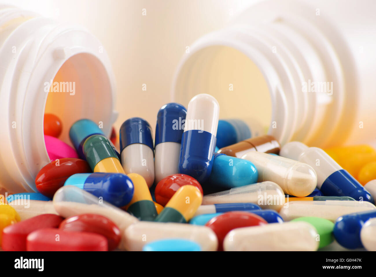 Composition with variety of drug pills and container. Stock Photo