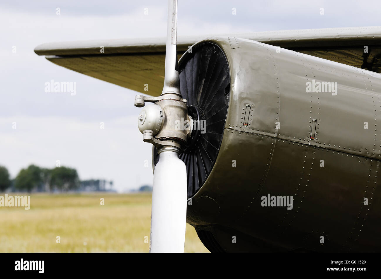 Private propeller-driven airplane over blurry background - Stock Image