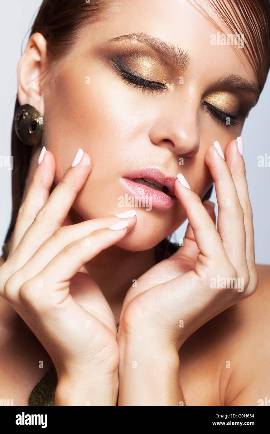 Woman With Wet Shining Makeup And Closed Eyes Stock Photo 103640240
